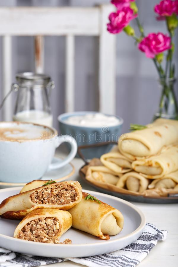 Thin crepe pancakes stuffed with beef meat and eggs. Traditional Russian cuisine. Maslenitsa royalty free stock photography