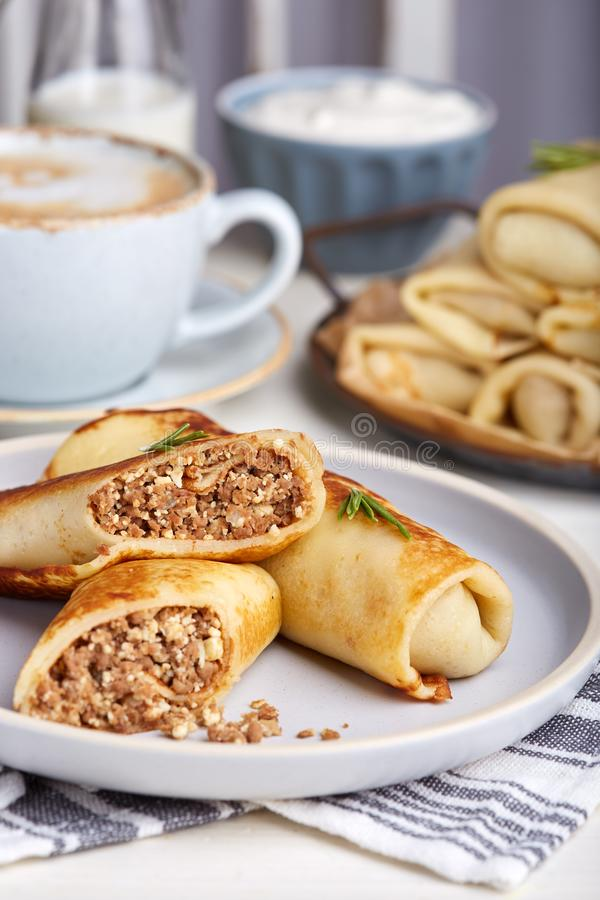 Thin crepe pancakes stuffed with beef meat and eggs. Traditional Russian cuisine. Maslenitsa royalty free stock images