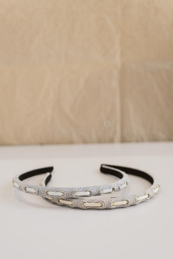 Thin hair band lie on the surface. Fashionable and stylish head decorations royalty free stock photo