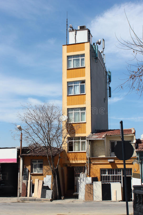 Thin and narrow five storey residential building in Istanbul, Turkey royalty free stock photo