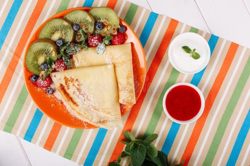 Thin Pancake with Fresh Fruit Kiwi Crepe Flatlay stock photography