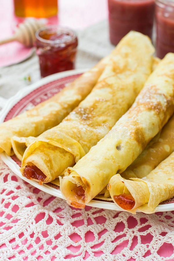 Thin pancakes crêpes with jam. On plate stock photography