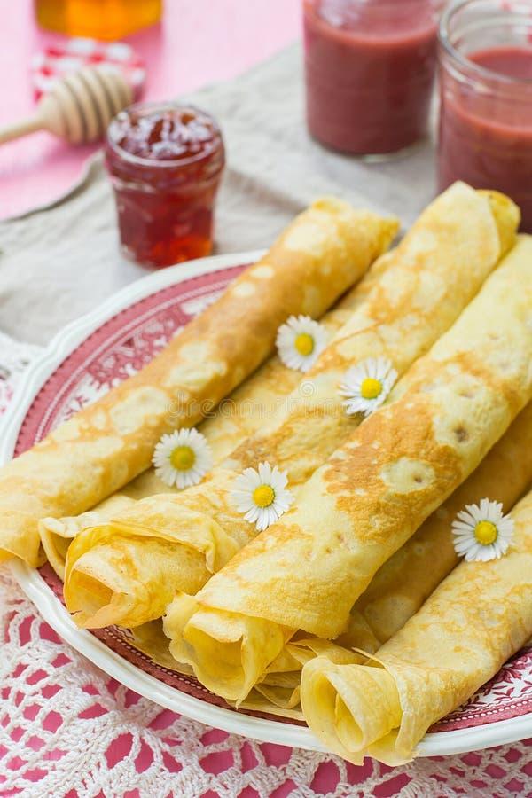 Thin pancakes crêpes with jam. On plate stock image