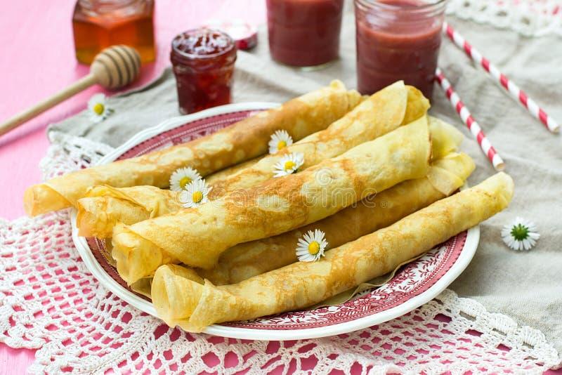 Thin pancakes crêpes with jam. And smoothie stock photo