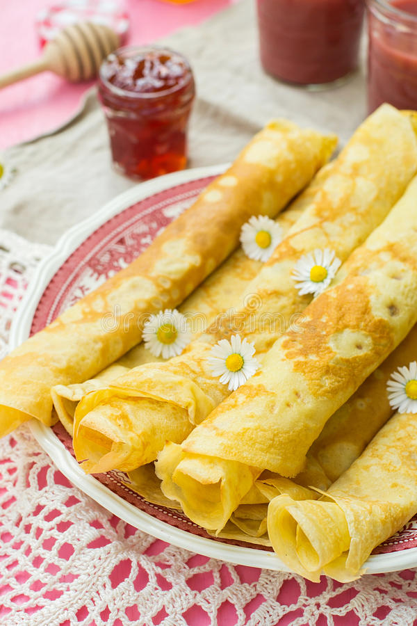 Thin pancakes crêpes with jam. And smoothie royalty free stock images