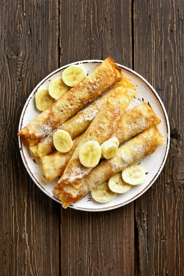 Crepes roll with banana slices stock image