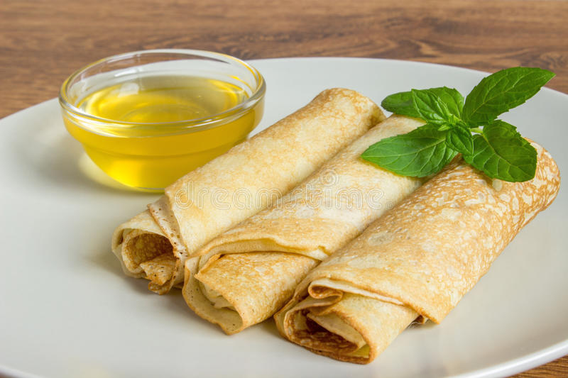Thin Pancakes on a plate Top View. Fresh Homemade Crepes. Thin Pancakes on a plate Background Top View. Fresh Homemade Crepes Flat Lay stock photography