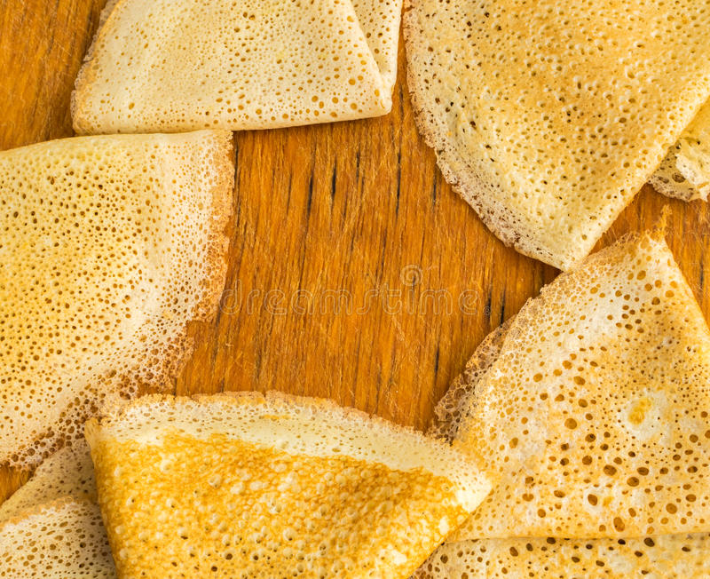 Thin Pancakes on a Wooden Background Top View. Fresh Homemade Crepes. Flat Lay royalty free stock photography