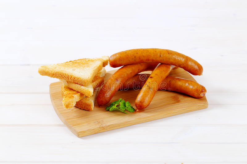 Download Thin sausages with toasts stock image. Image of frankfurter - 83707759