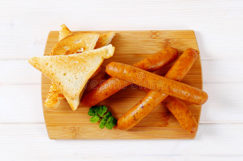 Download Thin Sausages With Toasts Stock Photo - Image: 83708239