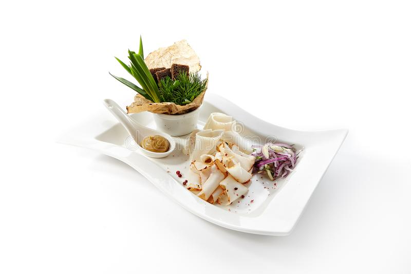 Thin slices of raw salted pork lard with spices stock photography
