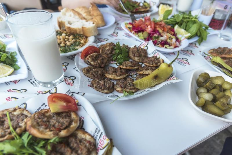 Thin turkish pita bread covered with minced meat and onions in Tarsus city. Turkish called `Lahmacun`. stock photography