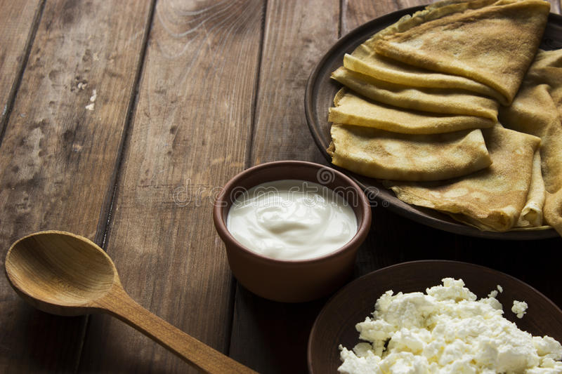 Thin Ukrainian Crepes, cottage cheese and sour creme royalty free stock photos