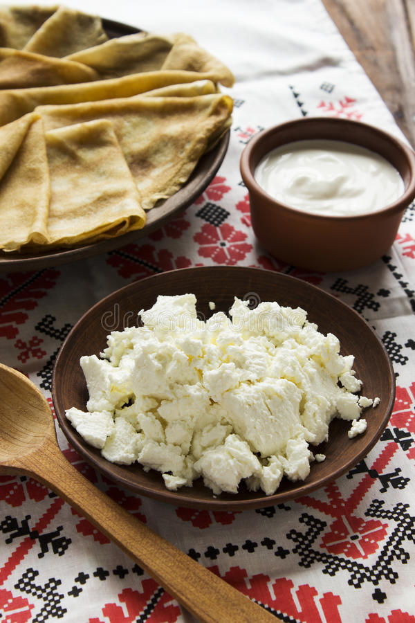 Thin Ukrainian Crepes, cottage cheese, sour creme in a crockery royalty free stock photos