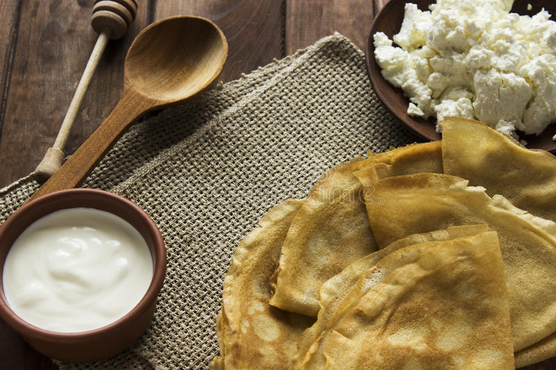 Thin Ukrainian Crepes, cottage cheese, sour creme in a crockery stock photos