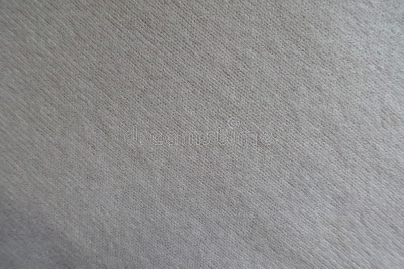 Thin white woolen knit fabric from above. Thin white woollen knit fabric from above stock image