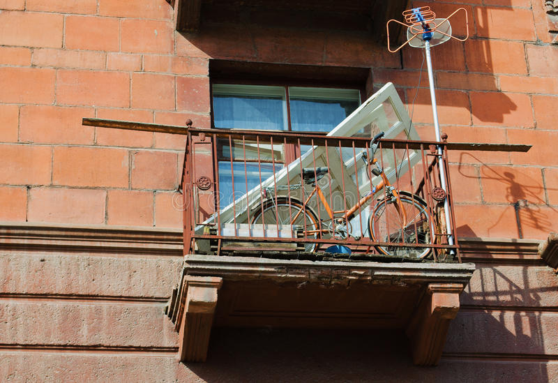 Things on a balcony. Many different things on an apartment house balcony in Russia stock photography