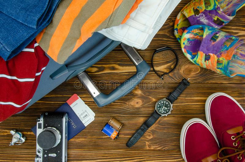 Things are collected in a suitcase. For travel stock photography