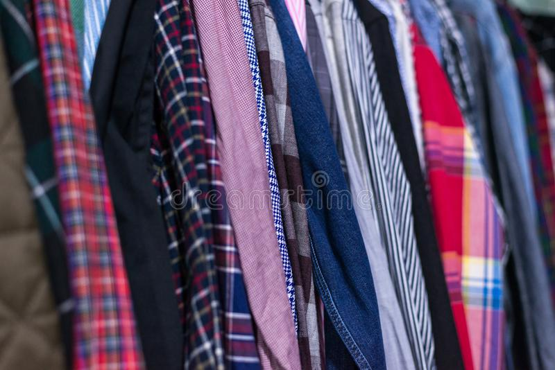 Things on hangers. Multicolored top dresses hang on hangers stock photography