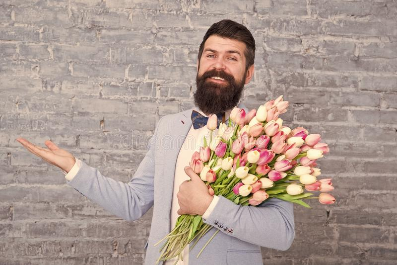 Things that make man gentleman. Romantic man with flowers. Romantic gift. Macho getting ready romantic date. Tulips for. Her. Man well groomed tuxedo bow tie stock images