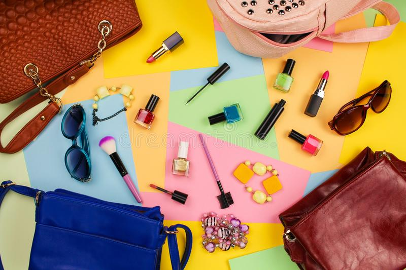 Things from open lady purses. Cosmetics and women`s accessories stock photography