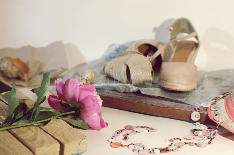 Things, shoes, hat, peony on the table, travel charges, trip. Seasonal rest stock image