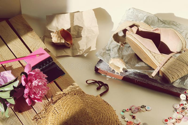 Things, shoes, hat, peony on the table, travel charges, trip. Seasonal rest royalty free stock photography