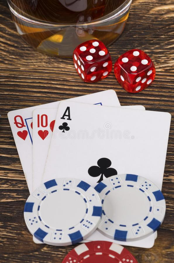 Things to play poker on a dark wood background stock image