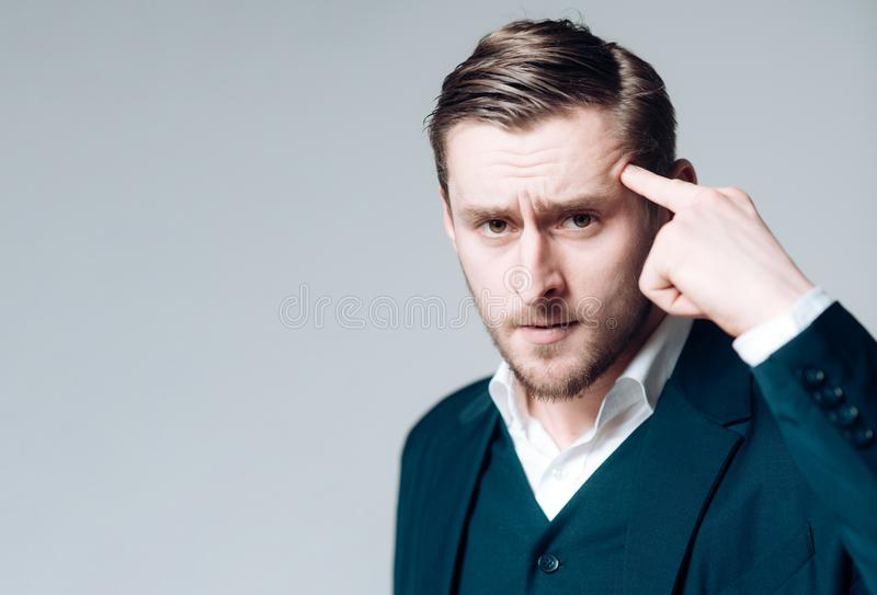 Think ahead of time. Thoughtful person. Man calm serious looking concentrated while touching head trying remember. Guy royalty free stock photography