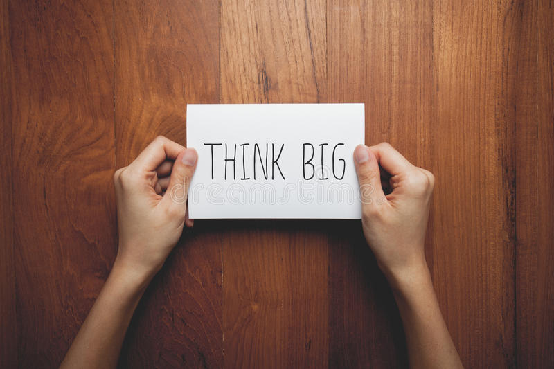 Think big message concept on paper stock images