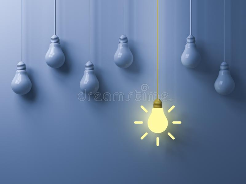 Think different concept One hanging yellow idea light bulb standing out from white unlit bulbs stock photo