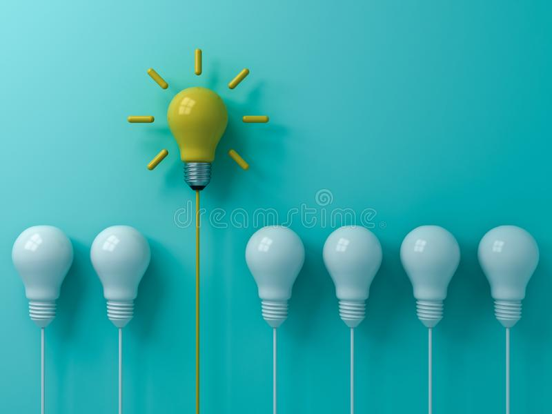 Think different concept One yellow idea light bulb standing out from the white unlit bulbs on blue green pastel color background royalty free stock image