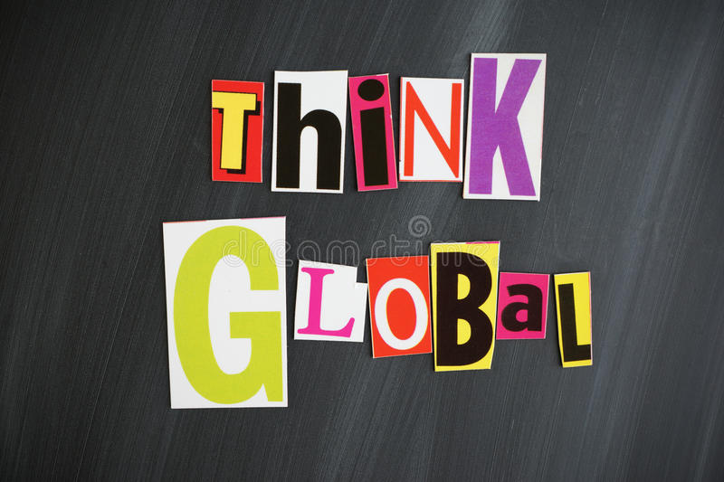 THINK GLOBAL. Letters on Chalkboard stock photography