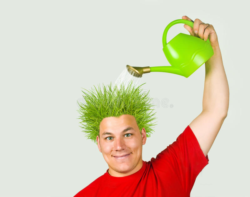 Think green!. Conservation - in love with nature- concept. Young man seems pleased with his new green hairdew stock images