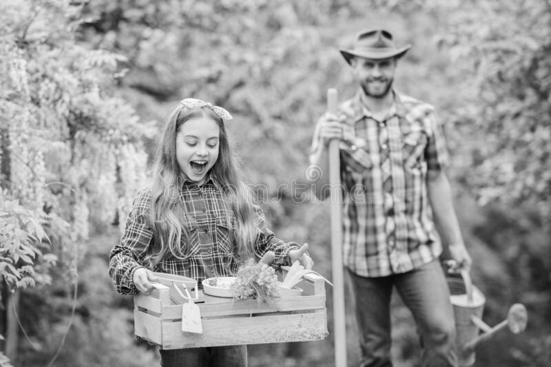 Think green. Gardener at work. ecology. Gardening tools. spring village country. family farm. little girl and happy man stock images