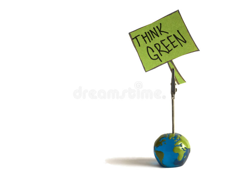 Think green note. Globe is holding a think green note stock photo