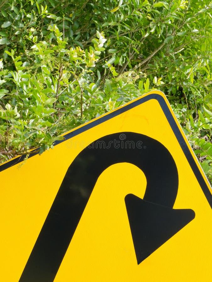 Download Think Green - U-turn Roadsign In Lush Vegetation Stock Image - Image: 25759815