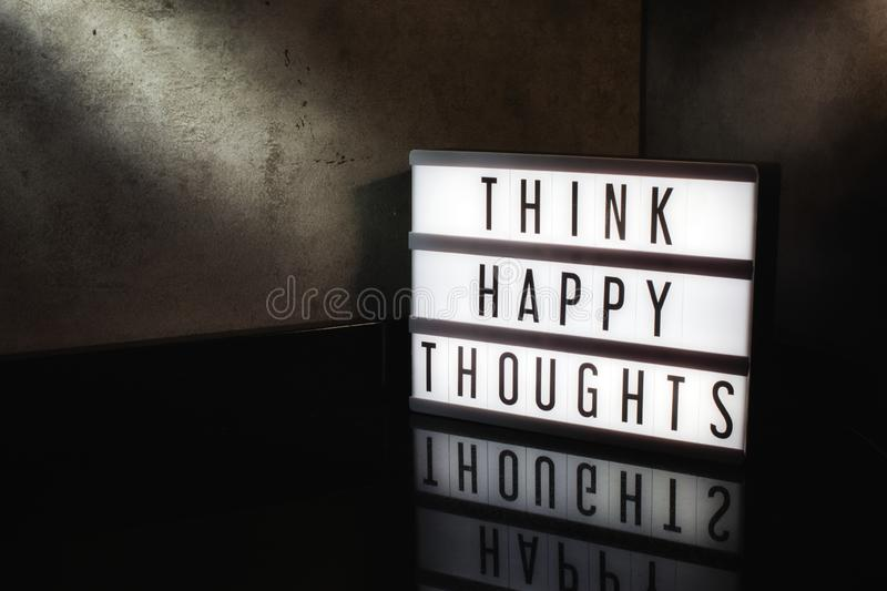 Think happy thoughts motivational message royalty free stock photo