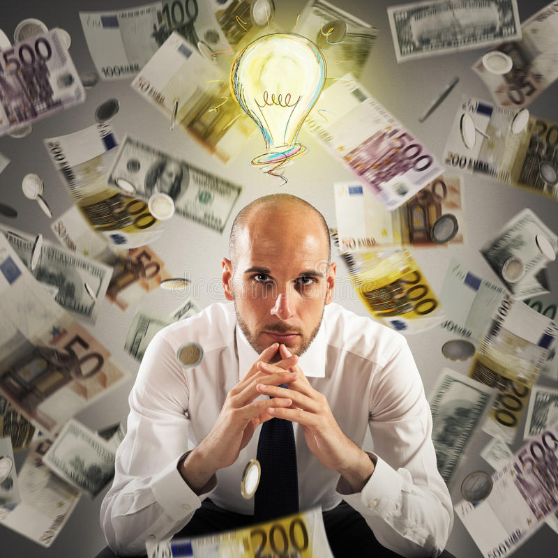 Think of how to get rich. Man with light bulb over his head and money background stock image
