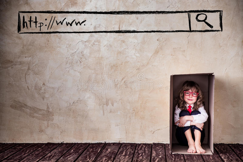 Think outside the box business concept. Portrait of child businessman in cardboadr box. Think outside the box business concept royalty free stock photography