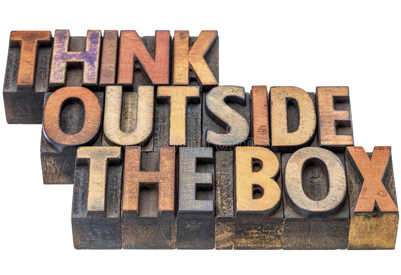 Think outside the box concept in wood type. Think outside the box - motivational concept in vintage letterpress wood type, stained by ink, isolated on white royalty free stock photography