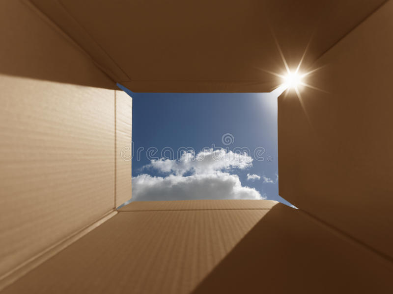 Think outside the box conceptual - Stock Image. Conceptual shot illustrating the phrase 'thinking outside the box'. Implies inspirational thoughts, bright new royalty free stock photos