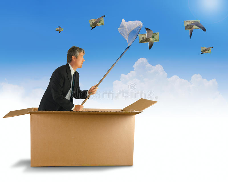 Think Outside the Box Creative Business Strategy Ideas. A man is trying to net the money that is flying by on the wings of birds as he is coming out of a box stock photos
