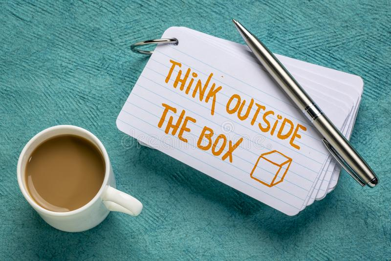 Think outside the box on index card. Think outside the box - handwriting on a stack of index cards with a cup of coffee and a pen vector illustration