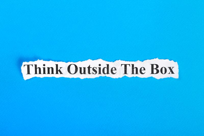 Think Outside The Box text on paper. Word Think Outside The Box on torn paper. Concept Image royalty free stock images
