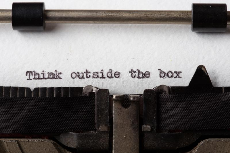 Think Outside The Box text on the typewriter royalty free stock photo
