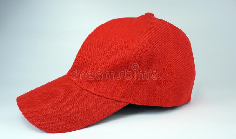Red cap on white background. Think red cap on white background sporty and energetic royalty free stock photography