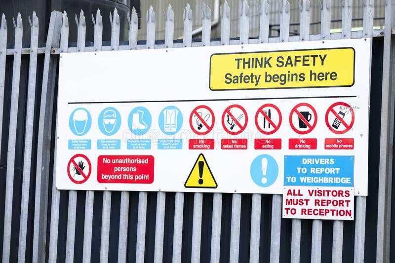 Think safety sign board at construction building site entrance royalty free stock images