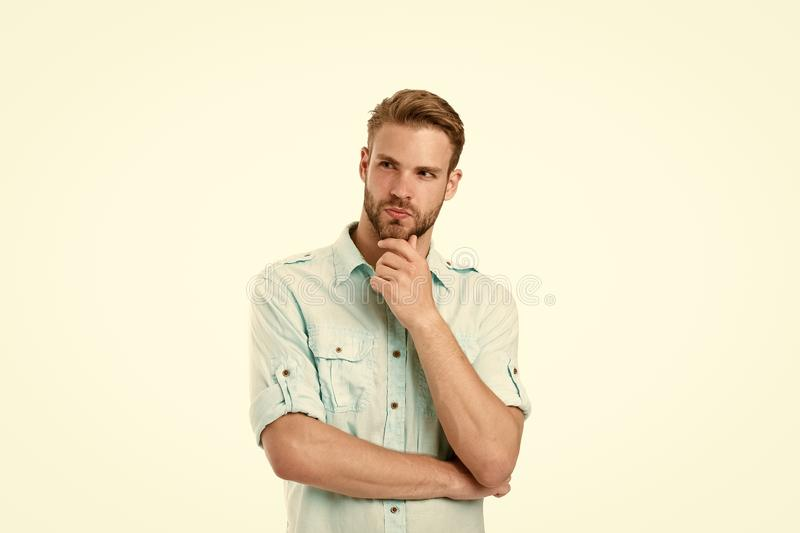 Think to solve. Man with bristle serious face thinking white background. Guy thoughtful touches his chin. Thoughtful royalty free stock images