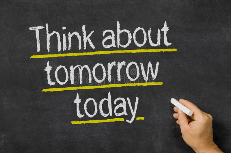 Think about tomorrow today. Blackboard with the text Think about tomorrow today royalty free stock photo